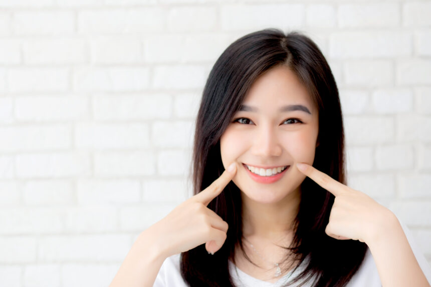 Portrait of beautiful young asian woman happiness standing finge